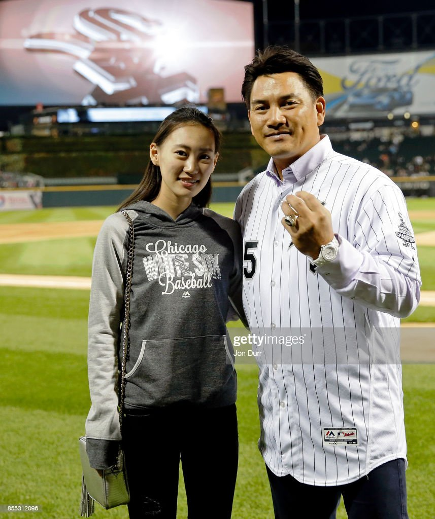 Former Chicago White Sox player Tadahito Iguchi poses for a photo with his daughter Rio Iguchi after he is honored by Naoki Ito (not pictured), consul general of Japan in Chicago, before the game between the Chicago White Sox and the Los Angeles Angels of Anaheim at Guaranteed Rate Field on September 28, 2017 in Chicago, Illinois.