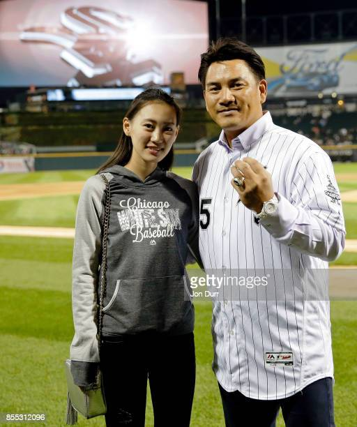 Former Chicago White Sox player Tadahito Iguchi poses for a photo with his daughter Rio Iguchi after he is honored by Naoki Ito consul general of...