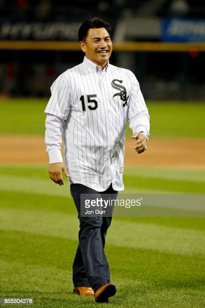 Former Chicago White Sox player Tadahito Iguchi smiles after throwing out a ceremonial first pitch before the game between the Chicago White Sox and...