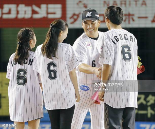 Former Chicago White Sox World Series winner Tadahito Iguchi receives flowers from his family after playing in the last game of his career at Zozo...
