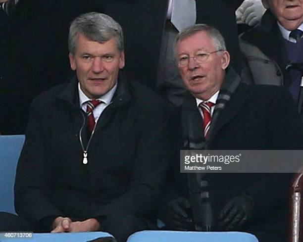 Former Chief Executive David Gill and former manager Sir Alex Ferguson of Manchester United watch from the director's box during the Barclays Premier...