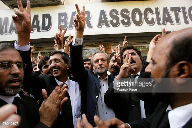 Former chief justice of the Sindh high court Wajihuddin Ahmed waves the victory sign with colleagues outside the Islamabad Bar Association on...