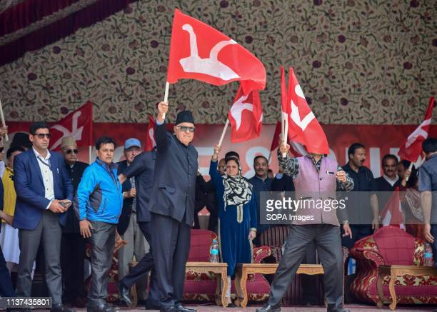 Former Chief Minister and President of National conference Farooq Abdullah seen waving their party flag during an election rally in Srinagar India is...