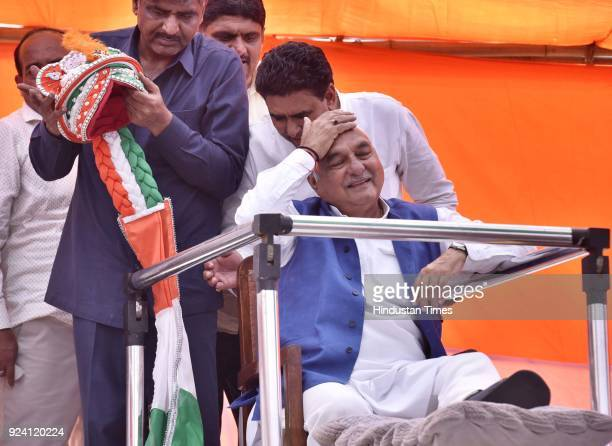 Former Chief Minister Bhupinder Singh Hooda welcomed by party workers during the JanKranti Rath Yatra Rally at Hodal Mandi on February 25 2018 in...