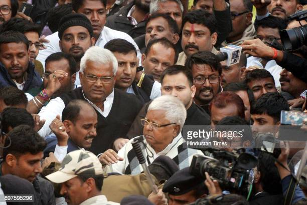 Former Chief Minister of Bihar Lalu Prasad under police custody with supporters proceeding to Birsa Munda Central Jail after his conviction in a case...