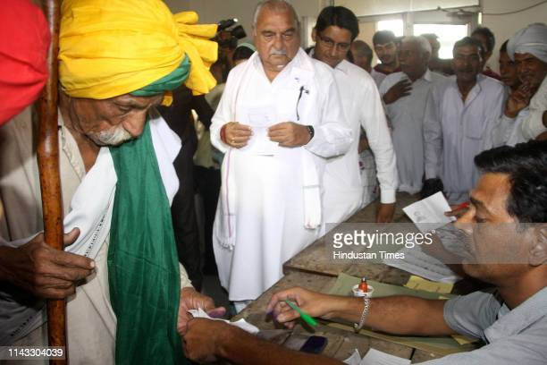 Former Chief Minister of Haryana Bhupinder Singh Hooda and his son Deepender Singh Hooda seen at a polling booth to cast their vote at Sanghi Village...