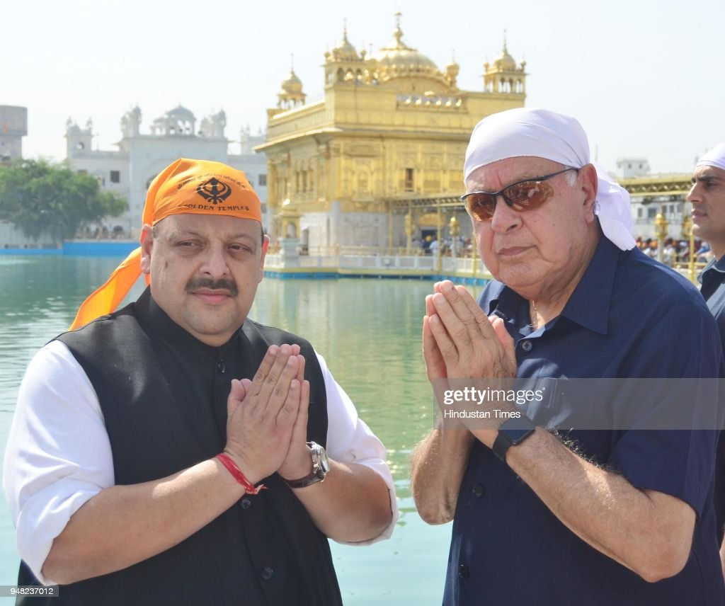 Former Chief Minister Of Jammu and Kashmir and President Of National Conference Farooq Abdullah with Devinder Singh Rana Provincial President of...
