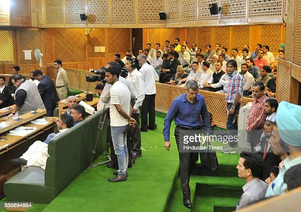 Former Chief Minister of Jammu and Kashmir Omar Abdullah walks out of the Assembly during a presentation of Budget on May 30 2016 in Srinagar India...