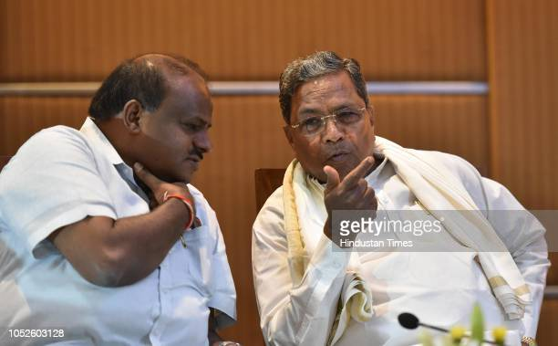 Former chief minister of Karnataka and the Chairman of Coordination committee Siddaramaiah and the Chief Minister of Karnataka H D Kumarswamy during...