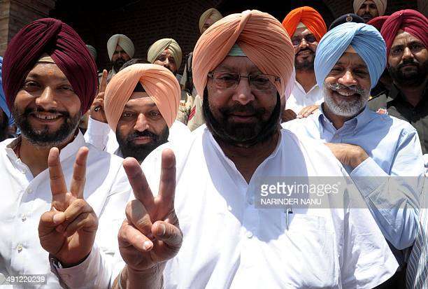 Former chief minister of the Indian state of Punjab and Congress Party candidate for Amritsar's parliamentary seat Amarinder Singh poses for a...