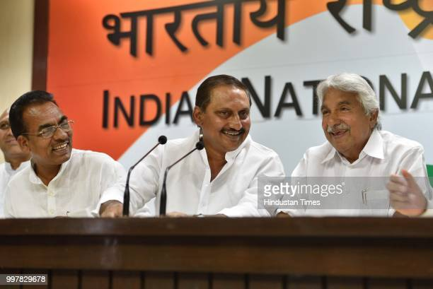 Former Chief Minister of United Andhra Pradesh Nallari Kiran Kumar Reddy speaks as AICC Andhra Pradesh incharge Oommen Chandy and other leaders looks...