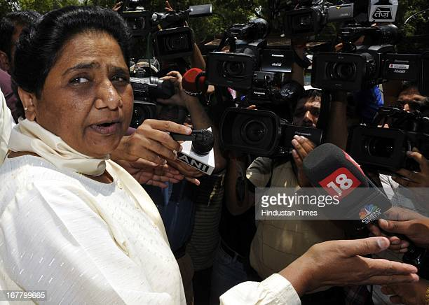Former Chief Minister of UP Mayawati Talking with media person before attending ongoing Parliament Budget session on April 30, 2013 in New Delhi,...