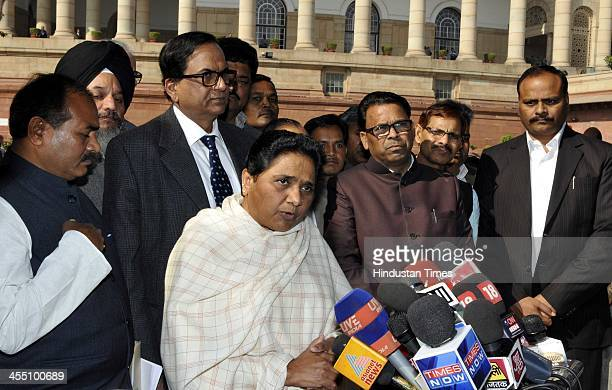 Former Chief Minister of Uttar Pradesh and Bahujan Samaj Party supreme Mayawati talks with media person after attending the ongoing Parliament Winter...