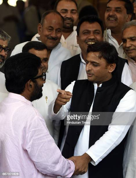 Former Chief Minister of Uttar Pradesh and President of Samajwadi Party Akhilesh Yadav meets Shiv Sena Lok Sabha MP Ravindra Gaikwad with other MPs...