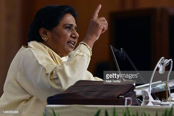Former chief minister of Uttar Pradesh state Mayawati whose party suffered a crushing defeat in he recently held elections speaks during a press...