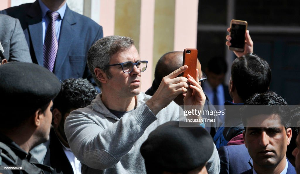 Former Chief Minister Omar Abdullah recording video during an election rally after National Conference Patron and President Farooq Abdullah filling his nomination paper for parliamentary elections on March 20, 2017 in Srinagar, India.