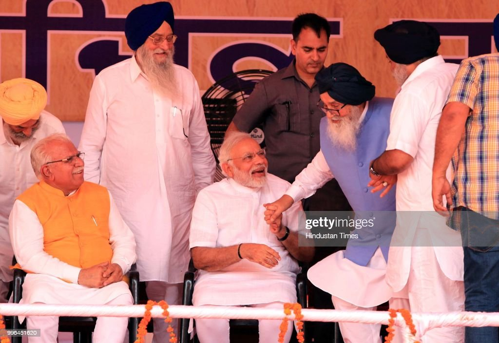Former Chief Minister Parkash Singh Badal leaving his chair holding the hand of Prime Minister Narendra Modi and his son and former Punjab deputy...