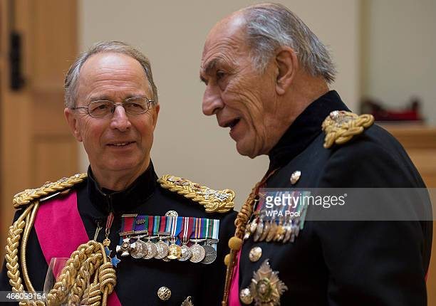 Former Chief of Defence Staff General Sir David Richards speaks with General Sir Michael Jackson during a reception at the Honourable Artillery...