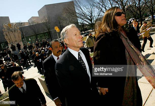 Former Chief of Staff to Vice President Dick Cheney I Lewis Scooter Libby and his wife Harriet Grant squeeze through members of the press with...