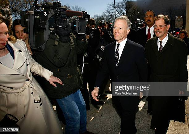 Former Chief of Staff to Vice President Dick Cheney I Lewis Scooter Libby walks with attorneys Theodore Wells and William Jeffress after the verdict...