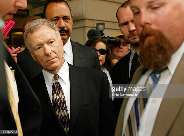Former chief of staff to Vice President Dick Cheney I Lewis Scooter Libby is followed by his lawyer Theodore Wells as he leaves the US courthouse...