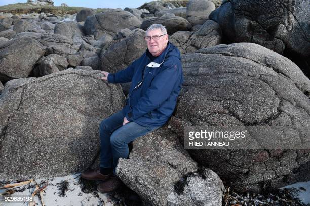 Former chief of the SNSM rescue boat La Portsallaise Frenchman Jean Lescop poses on Porsguen beach in Ploudalmezeau western France on February 22...