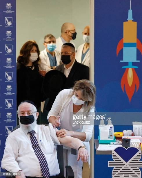 Former Chief Rabbi of Israel Yisrael Meir Lau gets vaccinated against COVID-19 coronavirus at Sourasky Medical Center in the Israeli coastal city of...