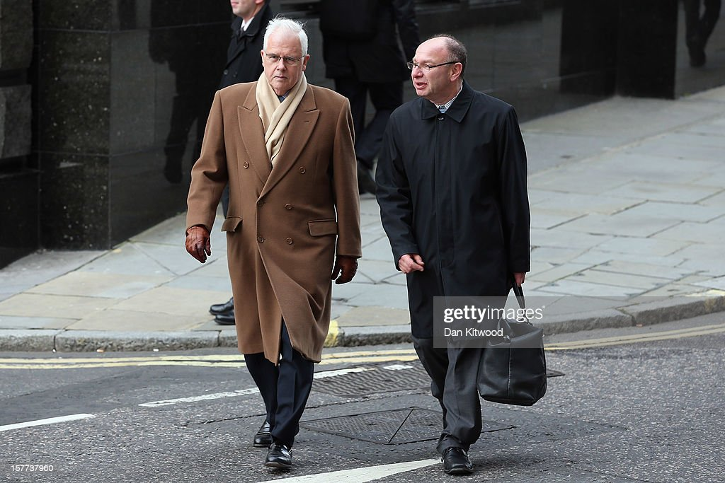Former chief Sun reporter John Kay (L) arrives at The Old Bailey on December 6, 2012 in London, England. Rebekah Brooks, Andy Coulson, Clive Goodman, John Kay and MoD employee Bettina Jordan-Barber have been charged as part of 'Operation Elveden,' the Metropolitan Police's investigation into corrupt payments to police and public officials. They all appeared today at the Old Bailey.
