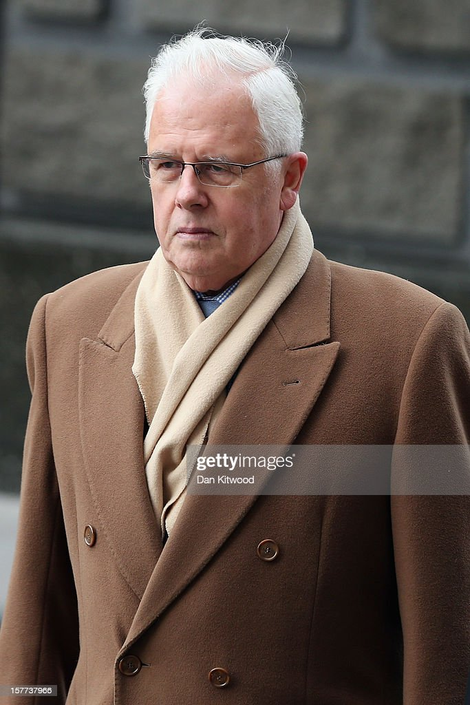 Former chief Sun reporter John Kay arrives at The Old Bailey on December 6, 2012 in London, England. Rebekah Brooks, Andy Coulson, Clive Goodman, John Kay and MoD employee Bettina Jordan-Barber have been charged as part of 'Operation Elveden,' the Metropolitan Police's investigation into corrupt payments to police and public officials. They all appeared today at the Old Bailey.