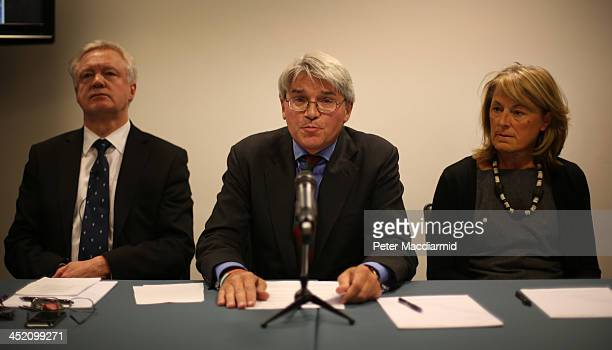 Former Chief Whip Andrew Mitchell is supported by his wife Dr Sharon Bennett and David Davies as he speaks to reporters on November 26, 2013 in...
