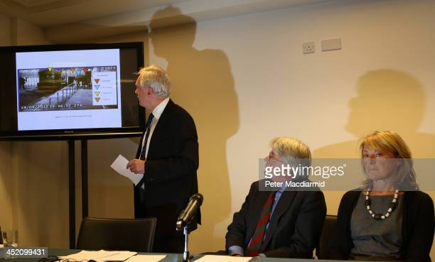 Former Chief Whip Andrew Mitchell sits with his wife Dr Sharon Bennett as David Davies shows video evidence to reporters on November 26, 2013 in...