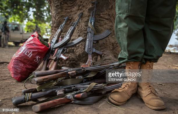 TOPSHOT A former child soldier stands next to rifles during the release ceremony for child soldiers in Yambio South Sudan on February 7 2018 More...