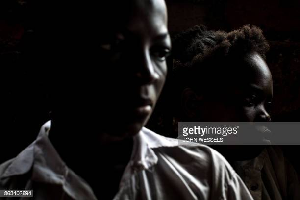 TOPSHOT Former child soldiers who were affiliated with the local antigovernment militia Kamwina Nsapu attend a math class at a school which assists...