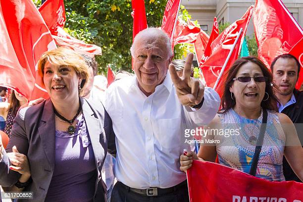 Former Chilean President Ricardo Lagos arrives accompanied by supporters of the Party for Democracy Council before making the proclamation as party...
