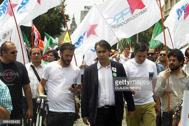 Former Chilean presidential candidate Marco Enriquez-Ominami takes part march demanding the creation of a constituent assembly to amend the 1980...