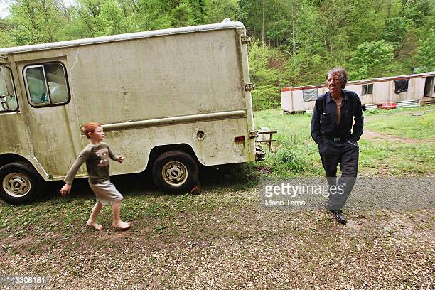 Former chimney sweeper Mose Noble and his nephew Johnny Noble gather outside Noble's trailer during a visit on April 21 2012 in Owsley County...