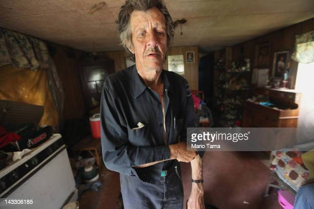 Former chimney sweeper Mose Noble stands in his trailer that lacks electricity or running water on April 21 2012 in Owsley County Kentucky Noble no...