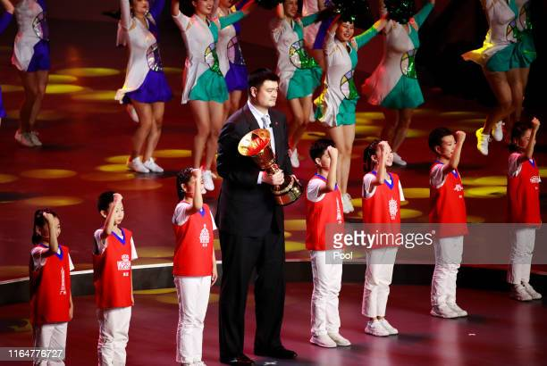Former Chinese NBA player Yao Ming holds the FIBA World Cup trophy during the FIBA Basketball World Cup 2019 opening ceremony at the Beijing National...