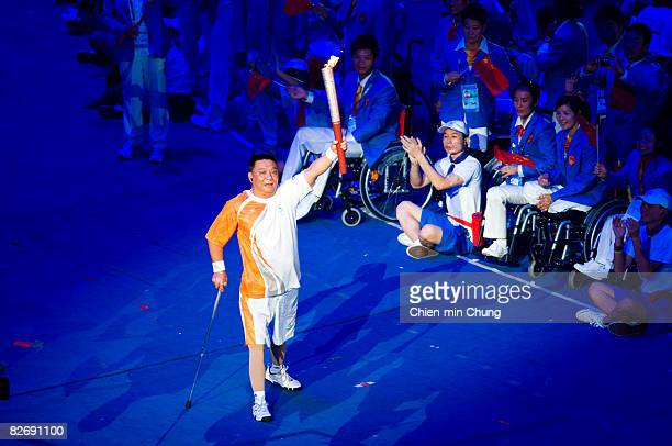 Former Chinese Paralympian Wu waves to the crowd during the Opening Ceremony for the 2008 Paralympic Games at the National Stadium on September 6...