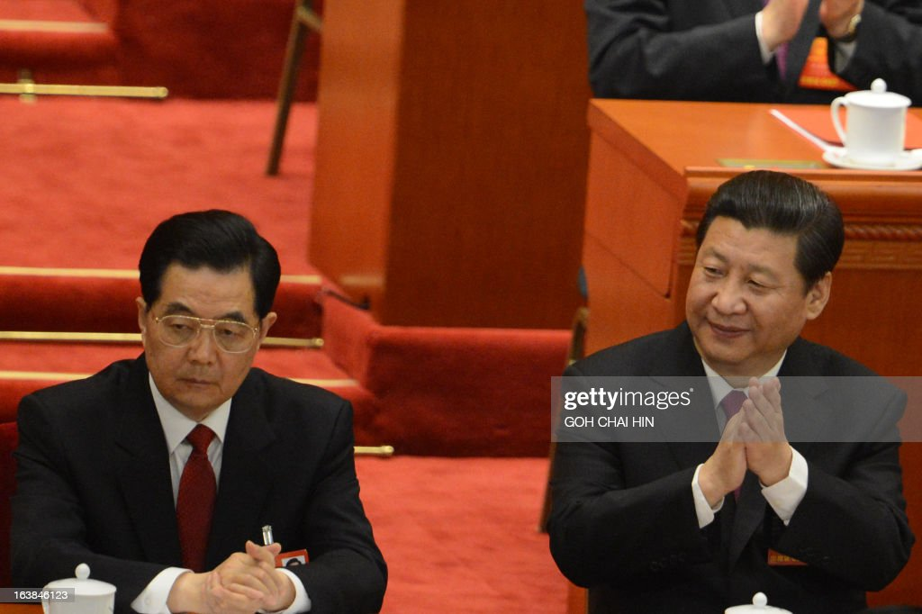 Former Chinese president Hu Jintao (L) and newly-elected Chinese President Xi Jinping attend the closing session of the National People's Congress (NPC) at the Great Hall of the People in Beijing on March 17, 2013. Xi said he would fight for a 'great renaissance of the Chinese nation', in his first speech as head of state of the world's most populous country.