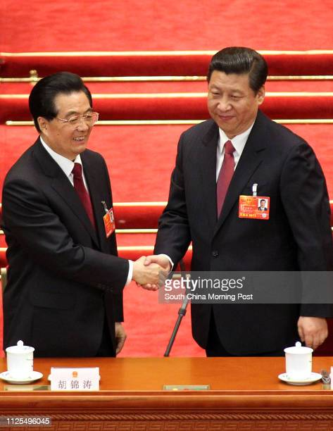 Former Chinese president Hu Jintao congratulates Xi Jinping being elected as the new president at the NPC meeting. 14MAR13 == Photo by Simon Song ==