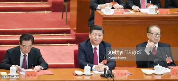 Former Chinese President Hu Jintao current President Xi Jinping and former President Jiang Zemin attend the closing ceremony of the Communist Party's...