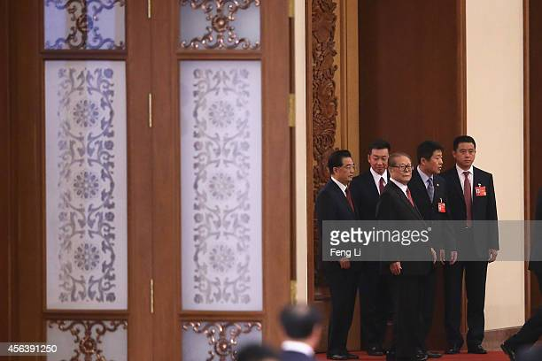 Former Chinese President Jiang Zemin and Hu Jintao arrive for the National Day reception marking the 65th anniversary of the founding of the People's...
