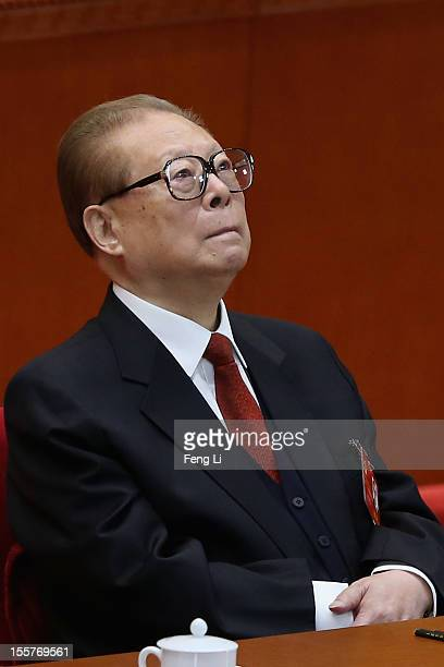 Former Chinese President Jiang Zemin attends the opening session of the 18th Communist Party Congress at the Great Hall of the People on November 8...