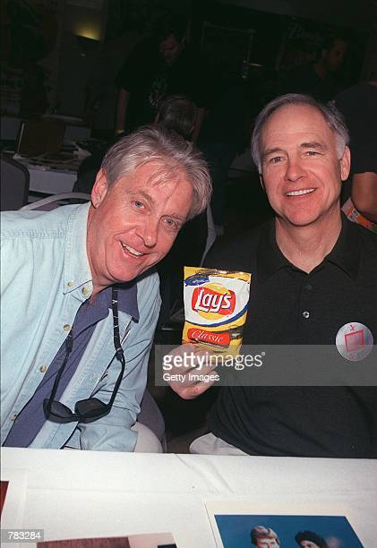 Former 'CHiPs' stars Paul Linke and Robert Pine hold up a bag of 'chips' at the Hollywood Collectors and Celebrity Show held at the Beverly Garland...
