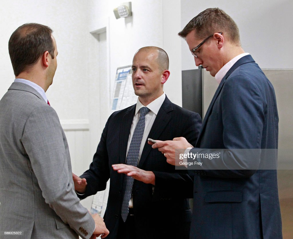Former CIA agent Evan McMullin (C), campaign worker Peter Watkins (L) and chief strategist Joel Sbarby, (R) talk before McMullin announced his presidential campaign as an Independent candidate on August 10, 2016 in Salt Lake City, Utah. Supporters gathered in downtown Salt Lake City for the launch of his Utah petition drive to collect the 1000 signatures McMullin needs to qualify for the presidential ballot.