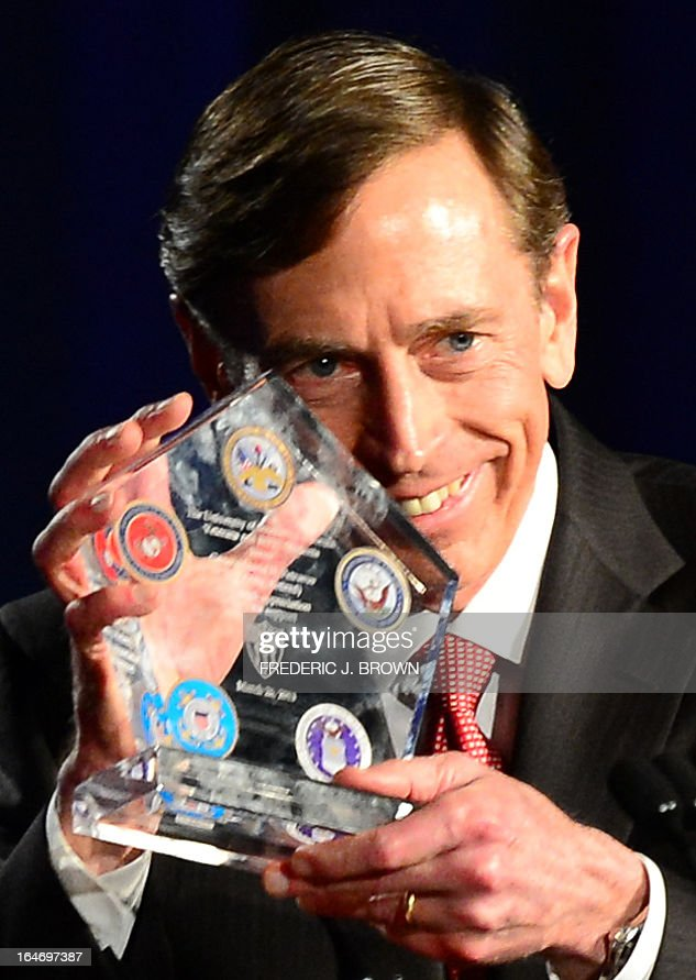 Former CIA director David Petraeus displays a token of appreciation presented to him following Petraeus' address at a University of Southern California event honoring the military on March 26, 2013 in Los Angeles, California. In the first public appearance since stepping down last November as head of the CIA after admitting to an affair, Petraeus said he regretted and apologized for the circumstances that led to his resignation. AFP PHOTO / Frederic J. BROWN