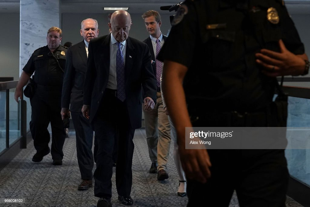 Former CIA director John Brennan (2nd L) and former director of National Intelligence James Clapper (3rd L) leave after a closed hearing before the Senate (Select) Intelligence Committee May 16, 2018 on Capitol Hill in Washington, DC. The committee held a hearing titled, 'Evaluating the January 2017 Intelligence Community Assessment on Russian Activities and Intentions in Recent Elections.'