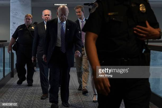 Former CIA director John Brennan and former director of National Intelligence James Clapper leave after a closed hearing before the Senate...