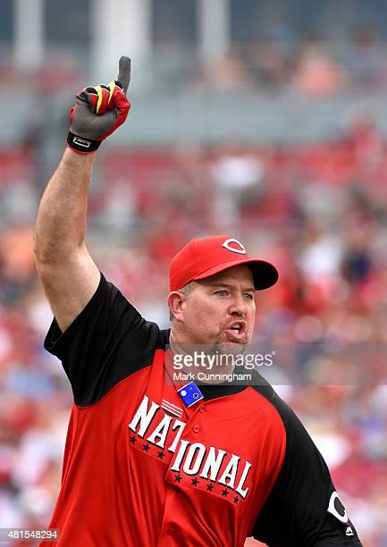 Former Cincinnati Reds and Major League Baseball player Sean Casey reacts after hitting a home run during the 2015 MLB AllStar Legends Celebrity...